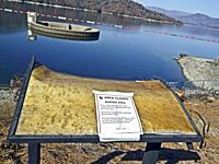 Melted sign remains on shore of Whiskeytown Lake in northern California following the 2018 Carr fire. The fire was started in July 2018 by a disabled ...