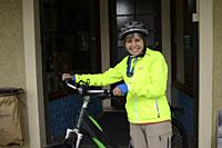 Woman, 68, with bicycle in South Island, New Zealand.