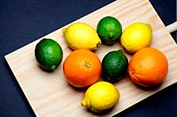 Lemons, Oranges and Limes on kitchen table