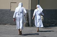 Two Christian nuns walking together in Domodossola, Piedmont, Italy.