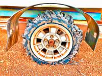 Shredded and flat trailer tyre on a dirt road in the Australian Outback.