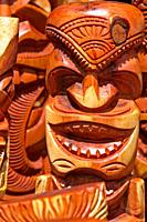Hawaiian carved wooden ancient faces and masks.