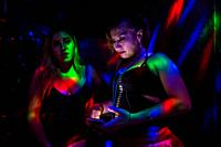A Salvadoran sex worker looks at the phone screen while talking with her co-worker in a sex club in San Salvador, El Salvador, 25 November 2018. Sex w...