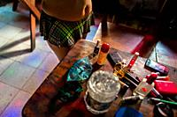 Cosmetics, makeup and beauty products are seen lying on the table before the beginning of the work shift in a sex club in San Salvador, El Salvador, 1...