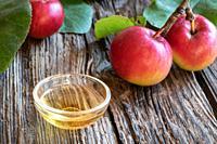 A bowl of apple cider vinegar with fresh fruit.