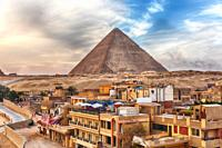 The Pyramid of Cheops and Giza town nearby, Cairo, Egypt.