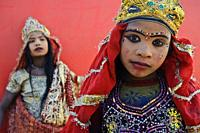 Two low caste hindu girls are impersonating the hindu goddess Kali ( Allahabad, India). They do it to earn some money.