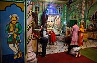Hindu devotees praying inside the Mahamati Prannathji temple at Panna ( Madhya pradesh, India).