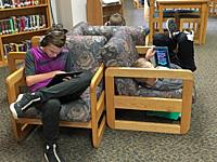 6th Grade Boys Relaxing in School Library, Wellsville, New York, USA.
