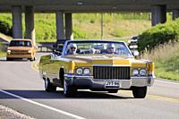 Salo, Finland. May 18, 2019. People cruising on classic yellow 1970s Cadillac convertible along highway on Salon Maisema Cruising 2019. Credit: Taina ...