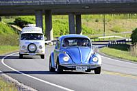 Salo, Finland. May 18, 2019. Classic 1970s Volkswagen Beetle, or Type 1 and white VW camper van, or Type 2 on road on Salon Maisema Cruising 2019. Cre...