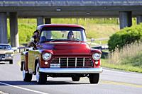 Salo, Finland. May 18, 2019. Woman drives a mid-1950s Chevy pickup, the male passenger is photographing on Salon Maisema Cruising 2019. Credit: Taina ...