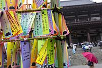 Colorful papers (Tanzaku) with the wishes of visitors on display during the Tanabata festival at Zojoji Temple on July 07, 2019, Tokyo, Japan. Every y...