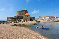 Tourists in kayak in front of Fort Mahon and shingle beach at Ambleteuse along rocky North Sea coast, Côte d'Opale / Opal Coast, France