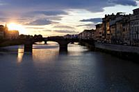 The evocative spring sunset over the Arno. Florence, Tuscany. Italy.
