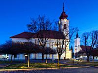Classicistic Roman Catholic and Calvinist churches in the town of Rimavska Sobota, Slovakia.