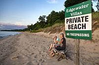 Union Pier, Michigan - A sign warns against trespassing on a private beach on the shore of Lake Michigan.