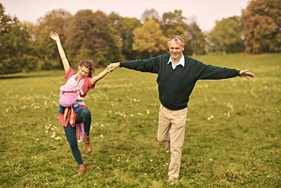 couple, baby, family, age difference, outdoors, in park, generations, Grandfather, at Neuhofener Berg, Munich, Germany.