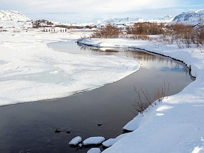River Oexara. Thingvellir National Park covered in fresh snow in Iceland during winter. Thingvellir is part of UNESCO world heritage. Northern Europe,...