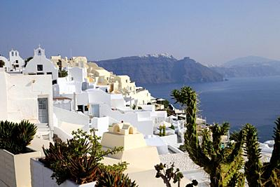 Houses in Oia with the sea and caldera, Santorin, Greece, Europe.