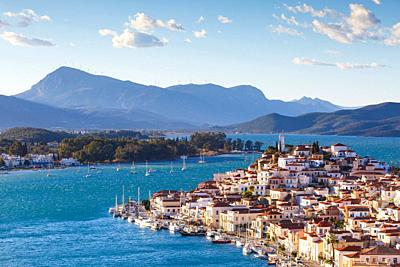 View of Poros island and mountains of Peloponnese peninsula in Greece. .