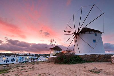 Old traditional windmills over the town of Mykonos. .