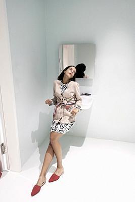 wistful stylish woman in bathroom