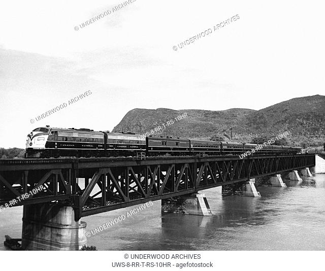 Canada: c. 1949.A Canadian Pacific passenger train crossing a trestle over a river