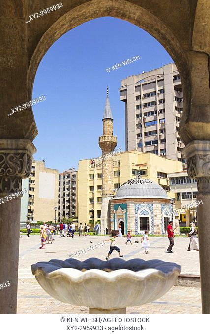 Izmir, Izmir Province, Turkey. Konak Square. The Yali, or Konak Mosque seen through an arch of the Clock tower