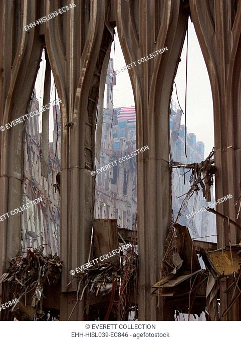 Fragment of the façade of WTC 1, the South Tower façade on Sept. 21, 2001. Through the center arch a flag can be seen on the damaged New York Telephone (now...