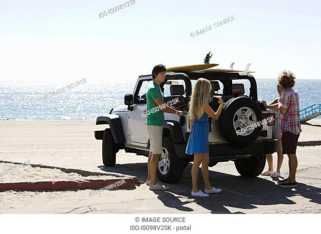 Friends by SUV at the coast