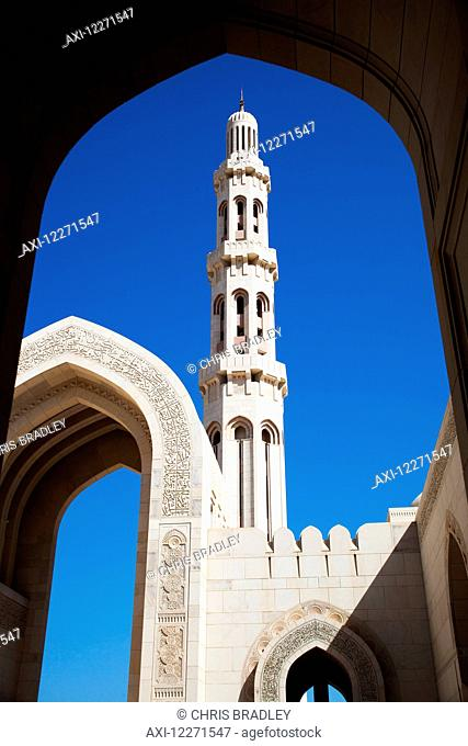 Minaret and inscribed archway, Sultan Qaboos Grand mosque; Muscat, Oman