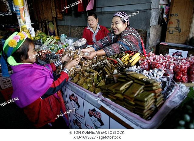 A Longneck girl buys vegetables at a market Approximately 300 Burmese refugees in Thailand are members of the indigenous group known as the Longnecks The...