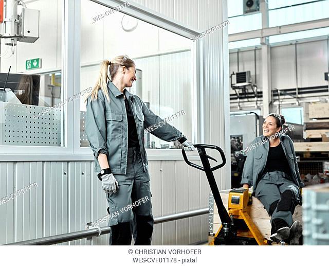 Industry, women using pallet jack