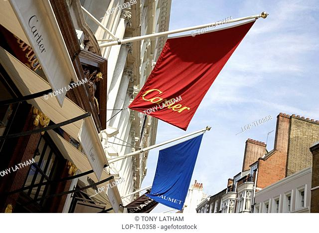 England, London, New Bond Street, A row of banners above shop fronts on New Bond Street