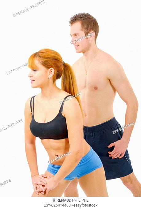 Beautiful young woman and man doing stretching exercises isolated on white background