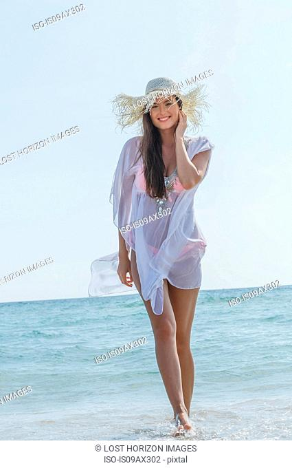 Portrait of beautiful young woman wearing sunhat on Miami beach, Florida, USA