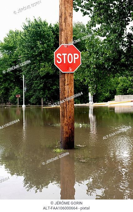 Stop sign on flooded street