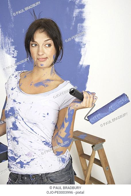 Woman painting home