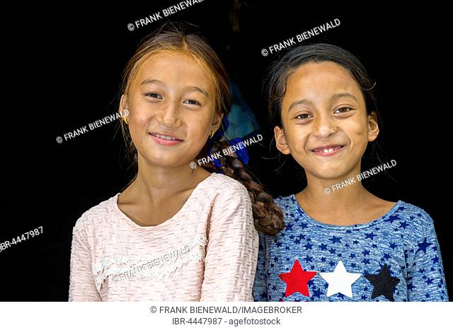 Two smiling girls, Portrait, Upper Marsyangdi valley, Tal, Lamjung District, Nepal
