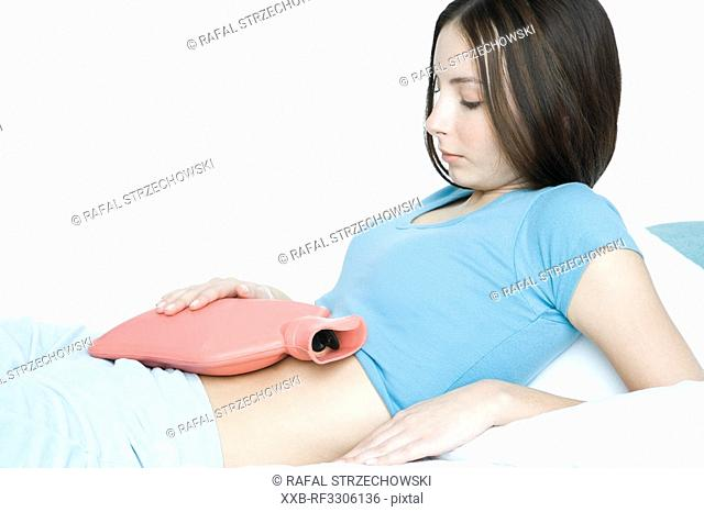 young woman with hot-water bottle