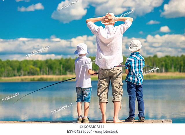 favorite hobby of men - fishing on a beautiful country lake