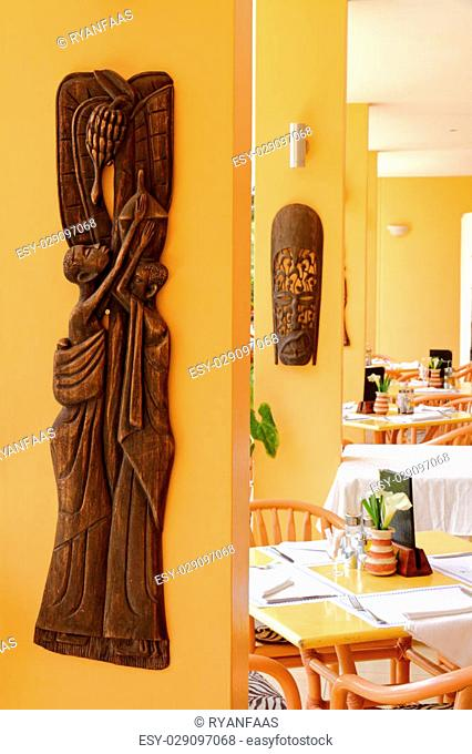 A dining area set up for customers in an african themed restaurant