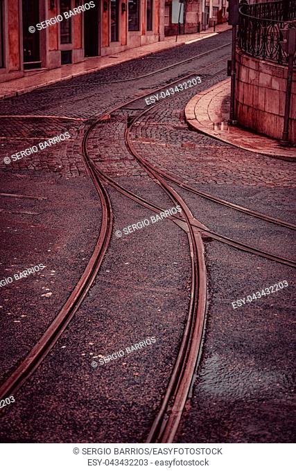 Tram tracks on a street in Lisbon, detail of a route for public transport in the city