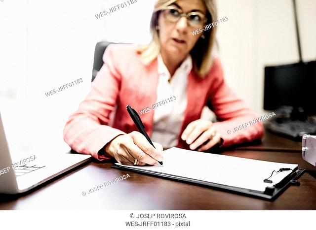 Businesswomen working on document in office