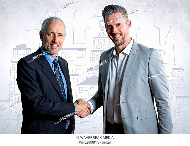 Business men shaking hands against white wall with city doodle