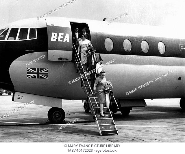 Passengers alighting from a B.E.A. aeroplane which has just landed at London (now London Heathrow) Airport, Middlesex, England