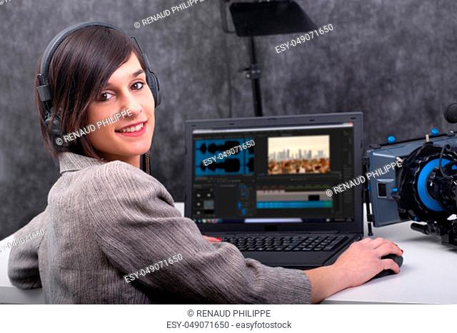 a smiling young woman video editor working in studio