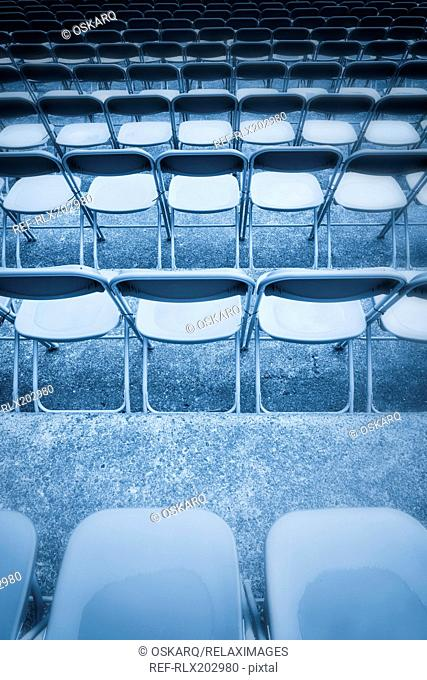 Blue toned black white row chairs grandstand wet