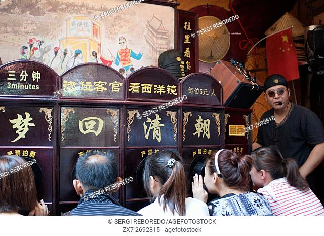 Shanghai Puppet Show in the ancient town, Shanhai. The Chinese love their children, and are restricted, if city dwellers, to but one